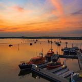 Sunset over Boats in Poole Harbour Royalty Free Stock Image