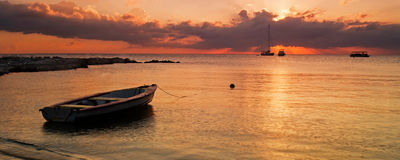 Sunset over boats seascape. This sunset was captured in Grand Cayman, Cayman Islands in Georgetown Royalty Free Stock Photography