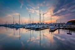 Sunset over boats on the waterfront in Canton, Baltimore, Maryland.  royalty free stock photo