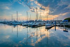Sunset over boats on the waterfront in Canton, Baltimore, Maryland stock image