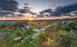 Sunset over Bodmin Moor in Cornwall. Dramatic sunset over Bodmin Moor in Cornwall on Garrow Tor Royalty Free Stock Image