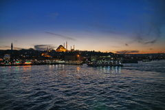 Sunset over Bosphorus channel, view over sea. Mosque at background Royalty Free Stock Image