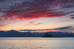 Sunset over Bourtzi castle, Greece. Royalty Free Stock Photo