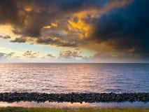 Sunset over breakwater Stock Image
