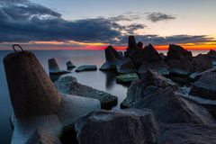 Sunset over breakwater Stock Photos