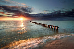 Sunset over breakwater in Ijsselmeer lake. Hindeloopen, Netherlands Royalty Free Stock Photos