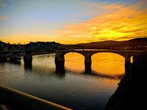 Sunset over bridge stock image