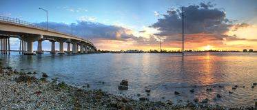 Sunset over the bridge roadway that journeys onto Marco Island,. Florida over the bay Royalty Free Stock Photos