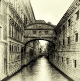 Sunset over the Bridge of Sighs b&w. Setting sun on a Summer evening as seen over a canal at the Bridge of Sighs in Venice, Italy Stock Image