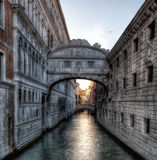 Sunset over the Bridge of Sighs. Setting sun on a Summer evening as seen over a canal at the Bridge of Sighs in Venice, Italy Stock Images