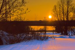 Sunset over the bridge. Sunset over the car bridge in a small Siberian city Royalty Free Stock Photos