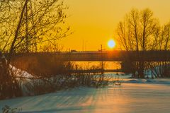 Sunset over the bridge. Sunset over the car bridge in a small Siberian city Stock Images