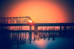 Sunset over the bridge. Sunset over the car bridge in a small Siberian city Stock Photography
