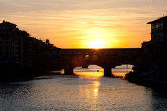Sunset over bridges through the river Arno Stock Photos