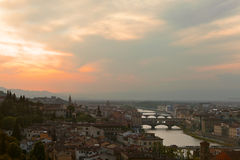 Sunset over bridges through the river Arno Stock Photography