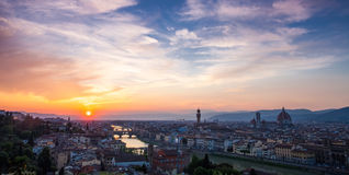 Sunset over bridges through river Arno in Florence, Italy Stock Images