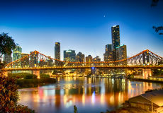 Sunset Over Brisbane. Story Bridge foreground, sun setting over Brisbane, Queensland, Australia stock image