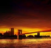 Sunset over a Brooklyn Bridge. Manhattan skyline with Brooklyn Bridge at sunset Stock Photos