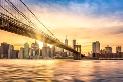 Sunset over Brooklyn Bridge in New York City. Brooklyn Bridge at sunset viewed from Brooklyn Bridge park, in New York City stock images