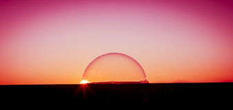 Sunset over the bubble world. Never say never, the dream come truth Royalty Free Stock Image