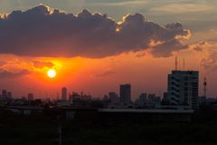 Sunset over the buildings in city.Skyline view of cityscape with sunlight royalty free stock image