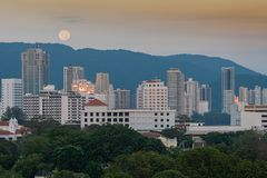 View of the city of Penang Malaysia. Sunset over the buildings of the downtown hull of the city of Penang surrounded by mountains Malaysia Royalty Free Stock Images