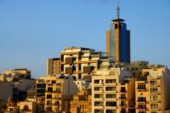 Sunset over the buildings of Malta Coast Stock Photos