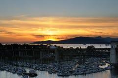 Sunset over Burrard marina. Golden sunset over Burrard marina, Vancouver, British Columbia, Canada Stock Photo