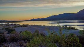 Sunset over Caballo Lake in New Mexico. The Caballo Mountains silhouette against the southwest sky behind Caballo Lake in southern New Mexico stock image