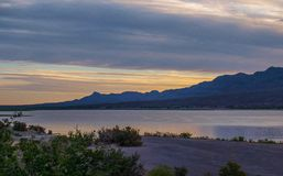 Sunset over Caballo Lake in New Mexico. The Caballo Mountains silhouette against the southwest sky behind Caballo Lake in southern New Mexico royalty free stock photography