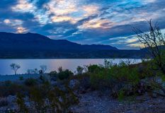 Sunset over Caballo Lake in New Mexico. The Caballo Mountains silhouette against the southwest sky behind Caballo Lake in southern New Mexico stock photos