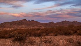 Caballo Lake Pink Sunset. Sunset over the Caballo Mountains behind Caballo Lake in southern New Mexico royalty free stock image