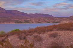 Sunset over Caballo Mountains and Lake. The Caballo Mountains are a spectacular backdrop for Caballo Lake State Park, just south of Truth or Consequences, New royalty free stock photos