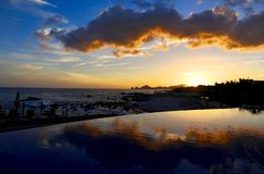 Sunset over Cabo San Lucas on a beautiful evening in Mexico. Mexican sunset over the Pacific Ocean in the seaside resort town of Cabo San Lucas stock photography
