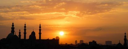 Sunset over Cairo. While the mosque is the main motive here, take closer look exactly underneath the setting sun and you will also see a pyramid stock images
