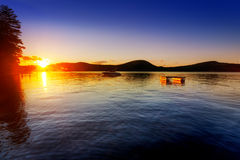 Sunset over calm lake Royalty Free Stock Images