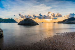 Sunset over calm tropical sea, Thailand. HDR view of calm tropical sea and beach at sunset, Thailand Royalty Free Stock Photography