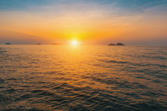 Sunset over the calm waters of the sea. Nature. Stock Photo