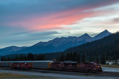 Sunset over Canadian Rockies. With an idle train in Field, British Columbia, Canada Royalty Free Stock Images