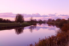 Sunset over canal in farmland Royalty Free Stock Images