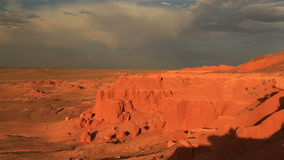 Sunset over the canyon Bayanzag in Mongolia stock video footage