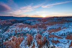 Sunset over canyon slopes covered in snow, Bryce Canyon National Stock Photo