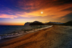 Sunset over the Cape Chameleon. The sunset and the picturesque view over the mountainous Massif of Kara-Dag and Cape Chameleon. Crimea. Shore of the Black sea Stock Photography