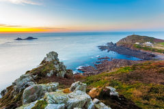 Sunset over Cape Cornwall. Sunset overlooking Sunset over Cape Cornwall from Carn Gloose with the Brisons on the horizon Stock Image
