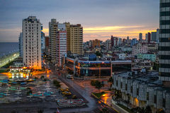 Sunset over the capital Havana, Cuba. Havana, Cuba - January 8, 2016: Typical scene of the Capital La Havana - Sunset over the capital Havana, Cuba overlooking Royalty Free Stock Image