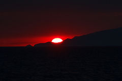 Sunset over Capri island. Italy. Photo taken from ferry departing island Royalty Free Stock Images