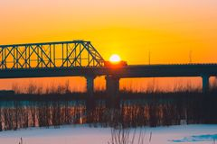 Sunset over the bridge. Sunset over the car bridge in a small Siberian city Royalty Free Stock Photography