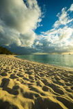 Sunset over a caribbean beach Royalty Free Stock Image