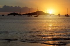 Sunset over Caribbean sea in Guadeloupe. View from Malendure beach towards Ilet Pigeon and Reserve Cousteau Royalty Free Stock Photo