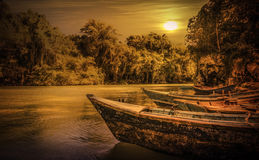 Sunset over caribbean wooden boats Stock Photo